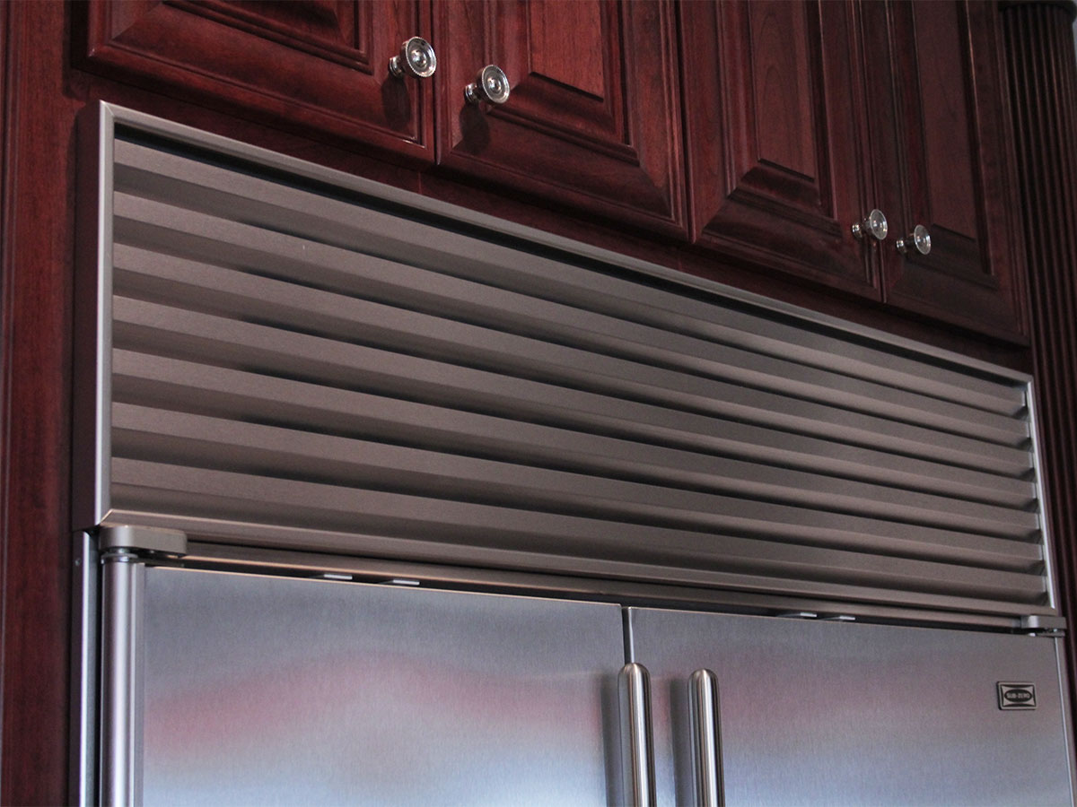 Clean refrigerator cooling coils and grill
