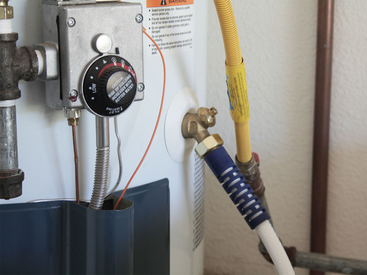 Flush water in hot water heaters