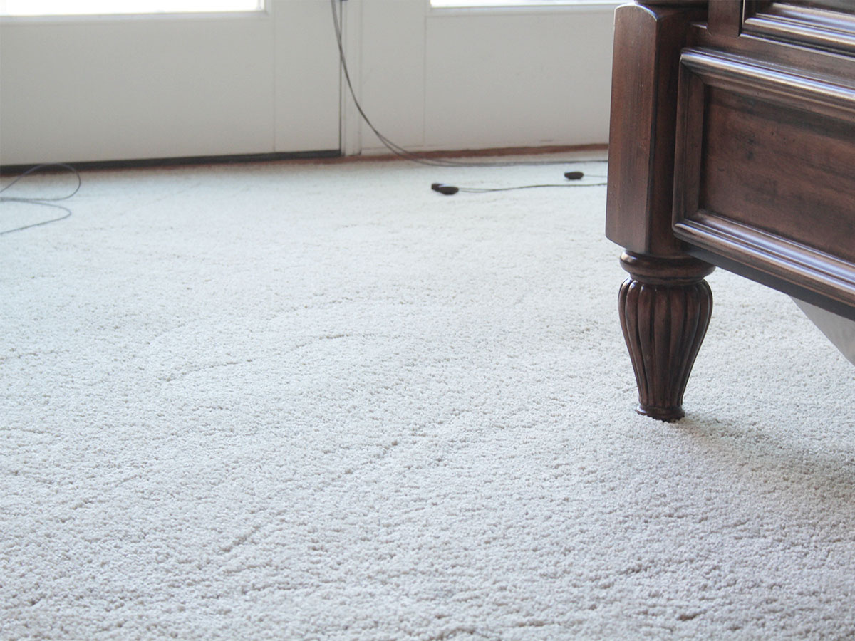 Inspect the carpet and remove any stains