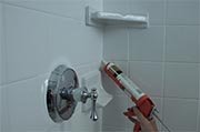 Inspect caulking in bathrooms Photo