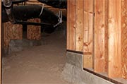 Inspect crawl space for water accumulation Photo