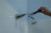 Remove mineral deposits from shower heads & faucets Photo