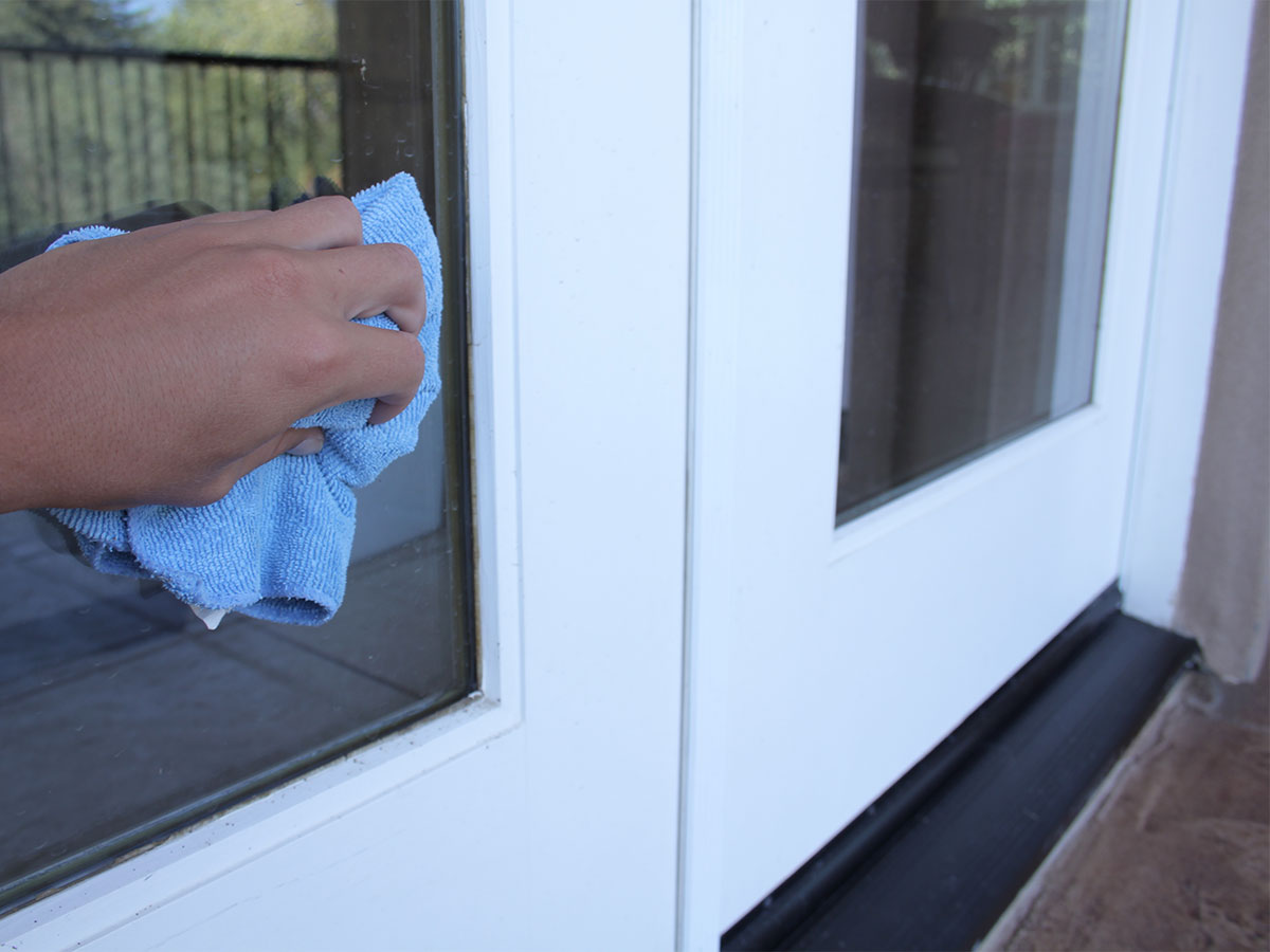 Wipe hand and pet prints from windows and glass doors